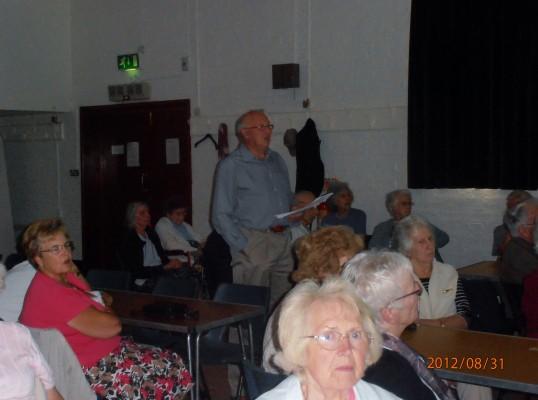 Peter Warren talking through photos being shown at the Wilburton over sixties club