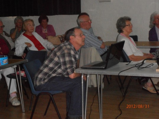 Ralph Carpenter (from Cottenham archive group) showing the photos on screen at Wilburton over sixties club