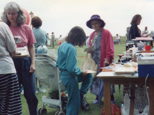 Wilburton garden fete stall with group of people