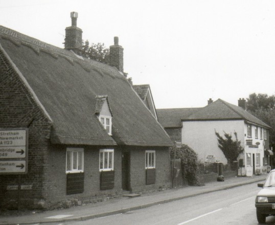 Post Office Wilburton, far right. Thatched cottage - old blacksmith's house