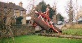 Wilburton High Street when agricultural machine came off the tractor and landed in the garden of number 76. No one was hurt.