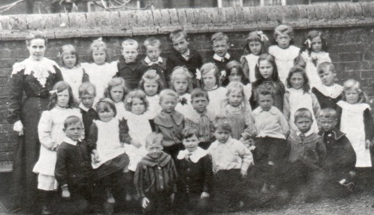 Mrs Alma Marchant with children from Wilburton Primary School, Cambridgeshire in about 1904.
