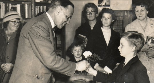 County librarian Mr. Houghton presented with a buttonhole at Wilburton.