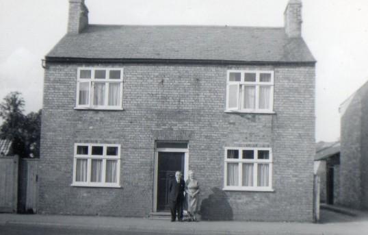 Wilburton couple at their front door