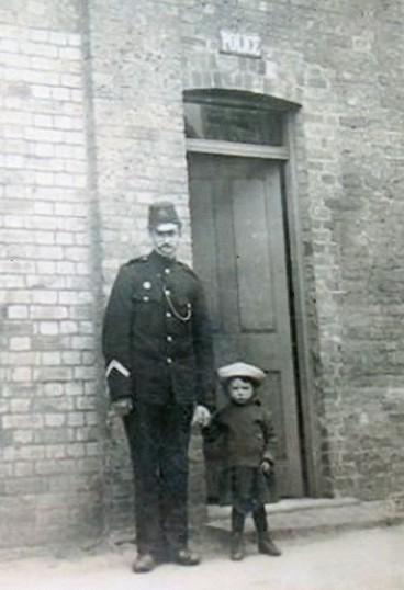 Policeman at Wilburton with his son