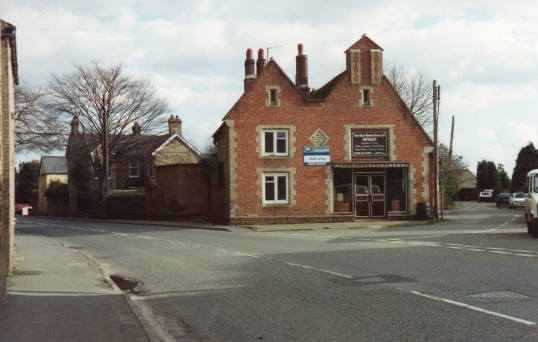 Front of old school building showing shop conversion at Wilburton.