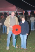Pete and Jenny with a large poppy! Money was raised for the Poppy Appeal during the 2006 Wilburton Fireworks (photo supplied by Purefotos)