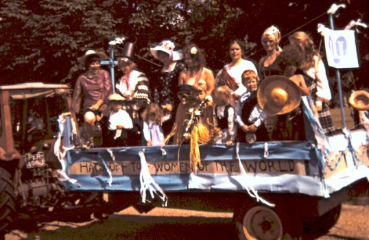 Hats Off To The Women of The World - a float at the Feast Parade