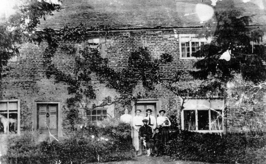 The King family outside Yew Tree House, Witcham