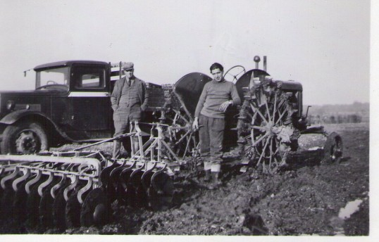 German prisoner of war Otto working at Orton Lodge Farm, London Rd., Yaxley with Mr Parker of the farm.