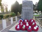 Poppy wreaths left at Yaxley War Memorial after Armistice Sunday.